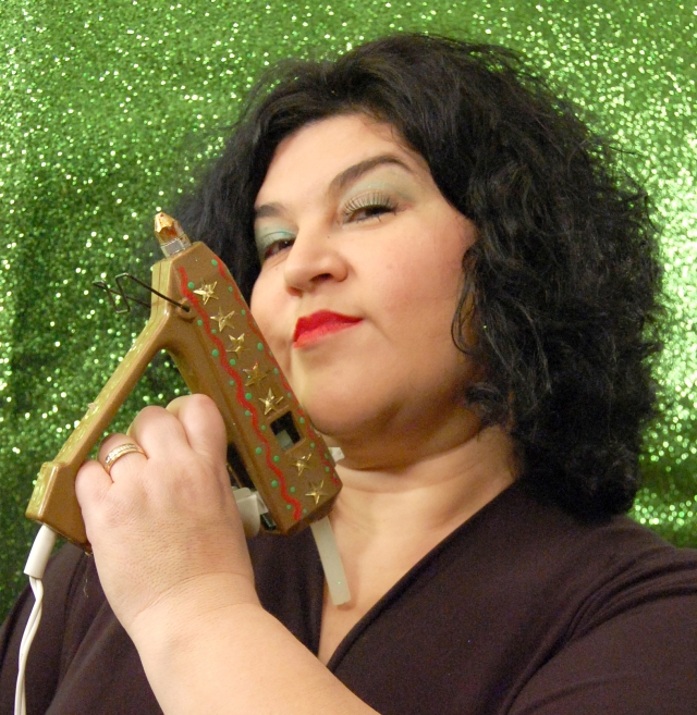 Kathy Cano-Murillo holding a golden glue gun