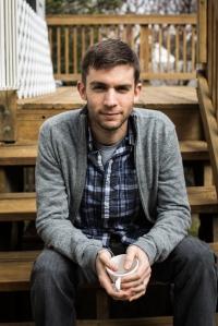 Russ Crandall, sitting on steps