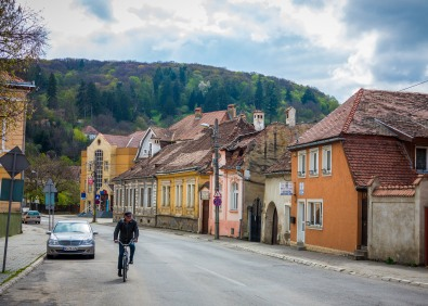 Man Cycling in Sighisoara by Erick Prince-Heaggans